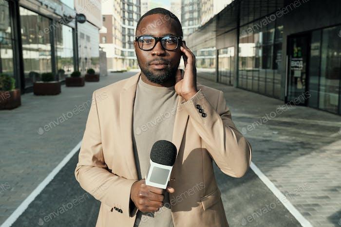 African journalist at work