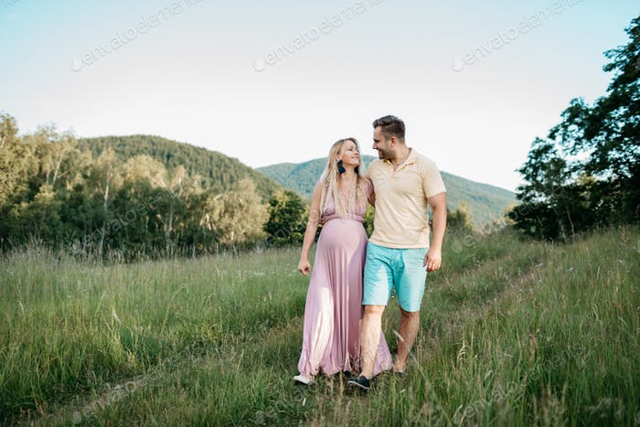 A couple in love walking in the nature on a summer day.