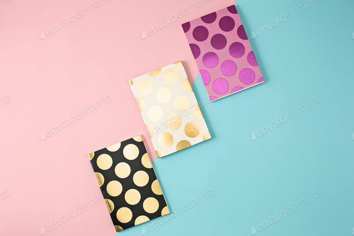 The three notebooks on colorful baground