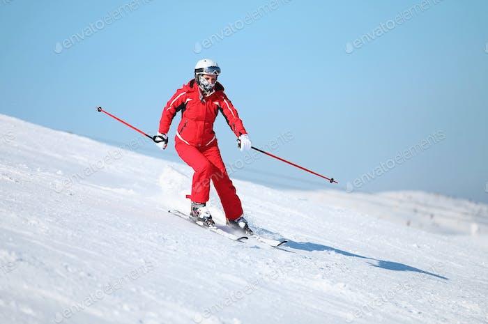 Girl skier on the slope at ski resort