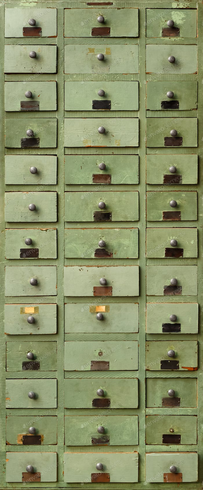 Old green wooden cabinet with drawers