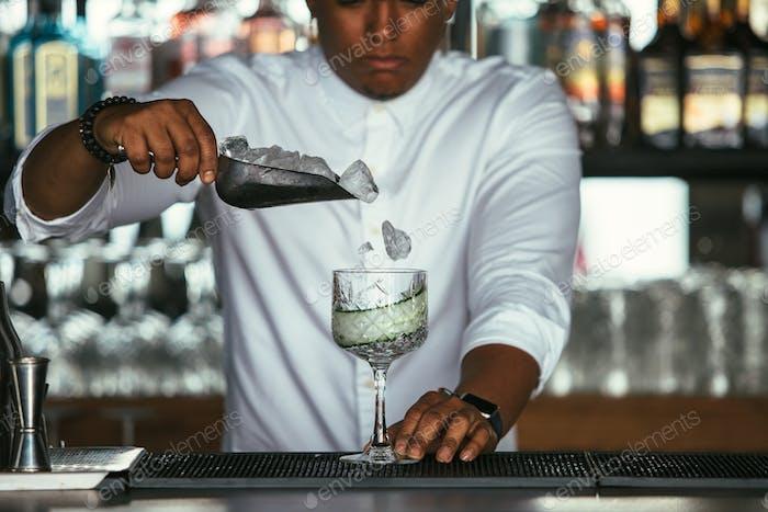 Bartender adding ice