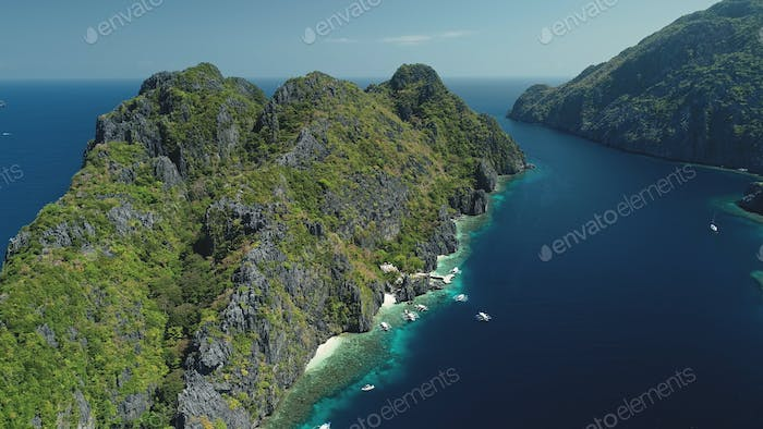 Tropic highland islands with green forest on rocks at sea gulf aerial view. Nobody nature landscape