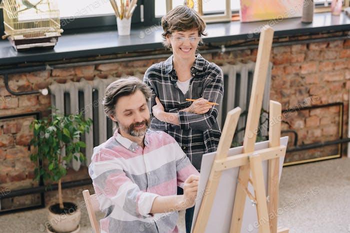 Mature Man Enjoying Art Class