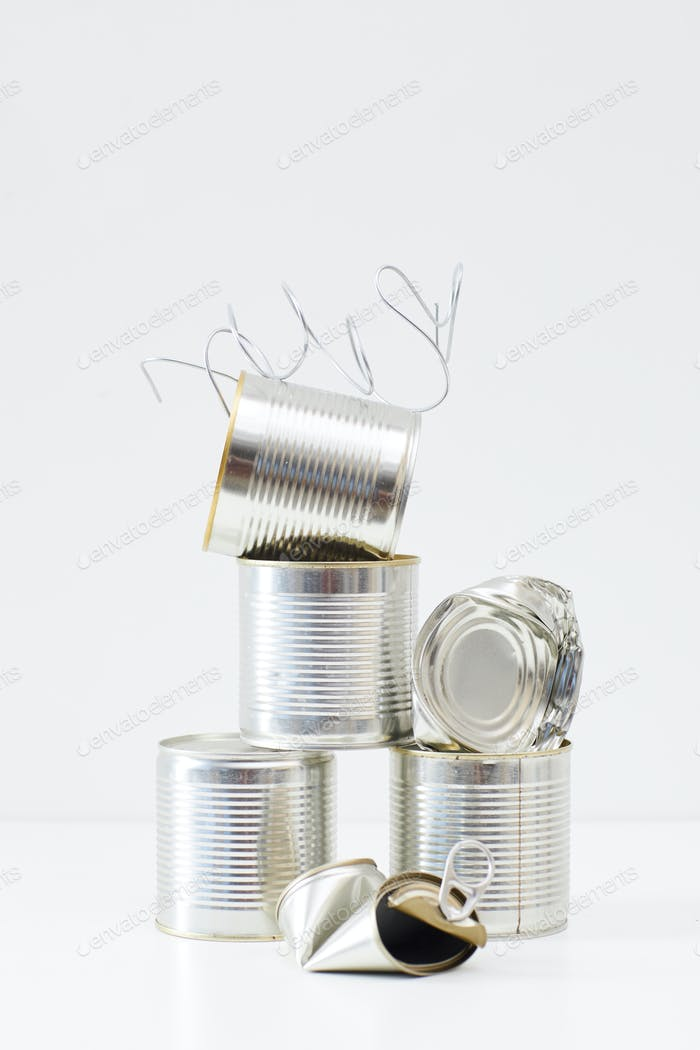 Discarded Metal Cans on White Background