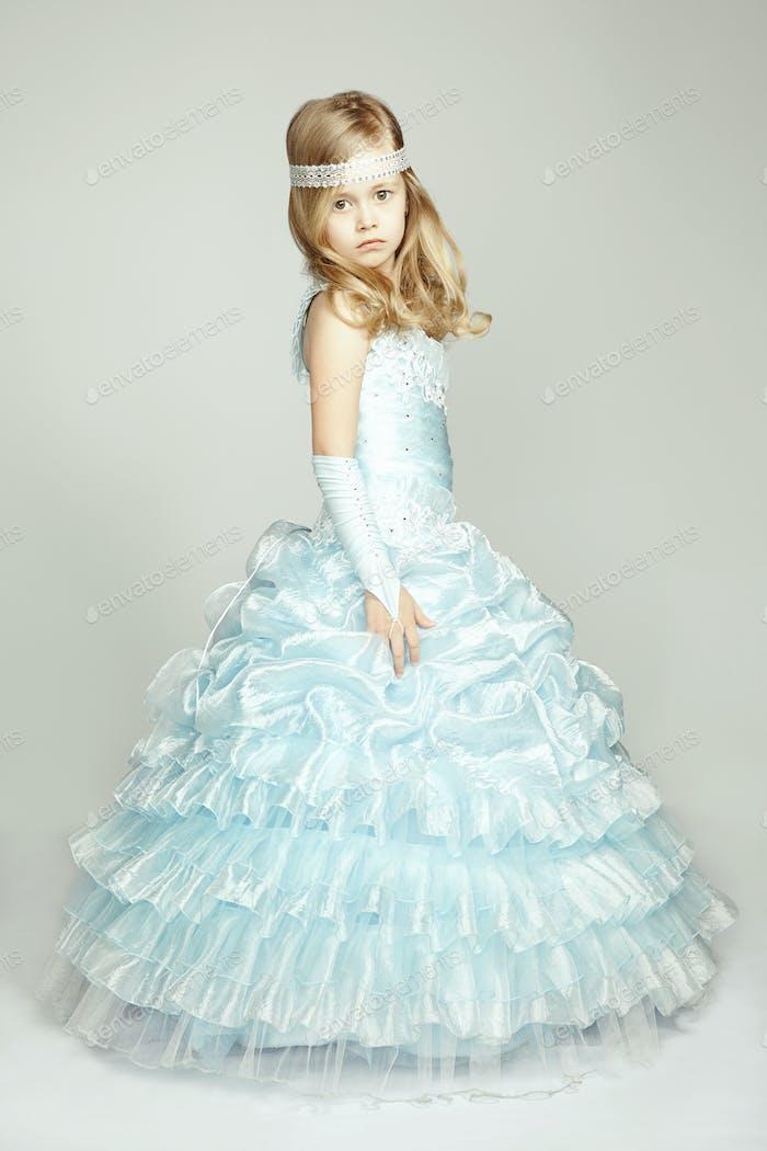 Portrait of little girl in luxurious dress
