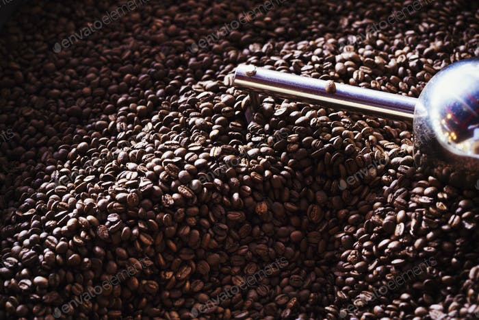 Specialist coffee shop. A heap of roasted brown coffee beans.