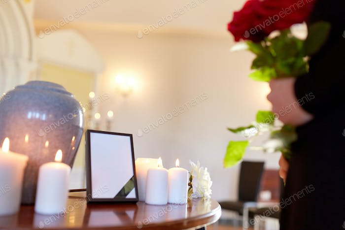 cremation urn and woman at funeral in church