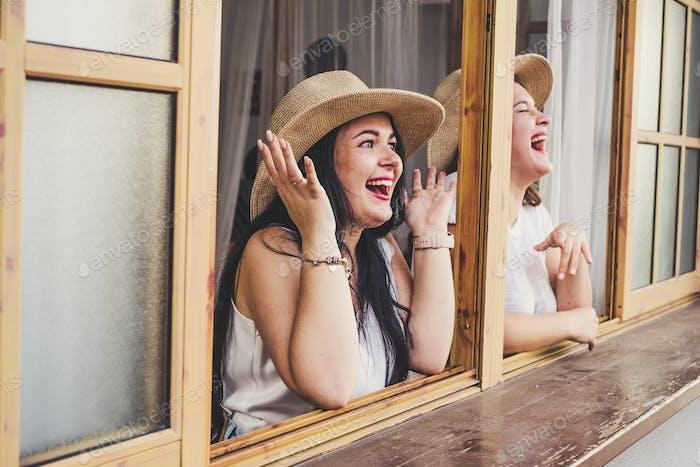 People having fun - couple of women laughing