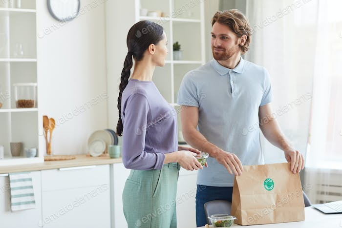 Couple getting food delivery
