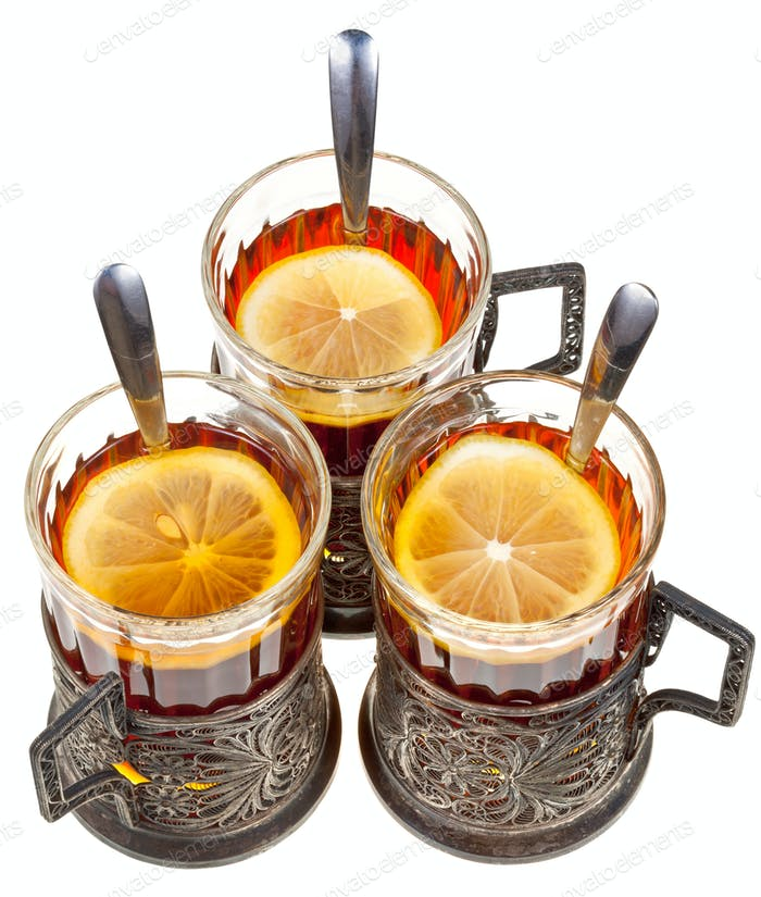 retro glasses with black tea and lemon