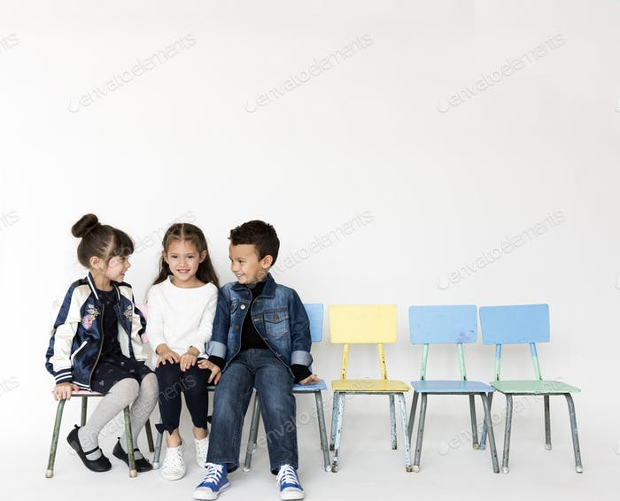Group of Schoolers Talking Smiling Together on White Background