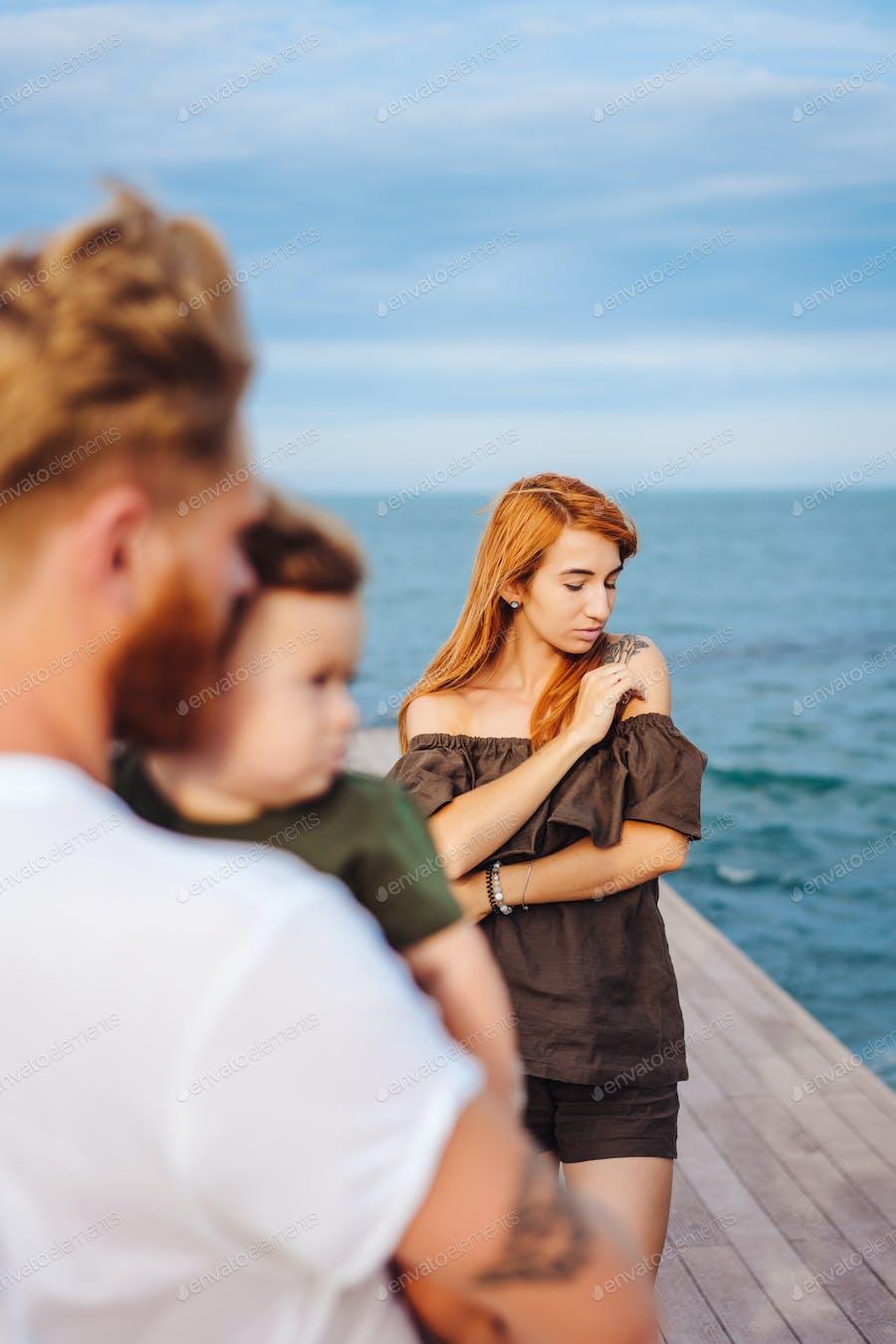 Happy Family on the Beach photo by EpicStockMedia on Envato