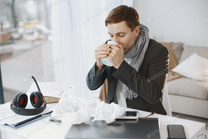 Young man ill with flu in office