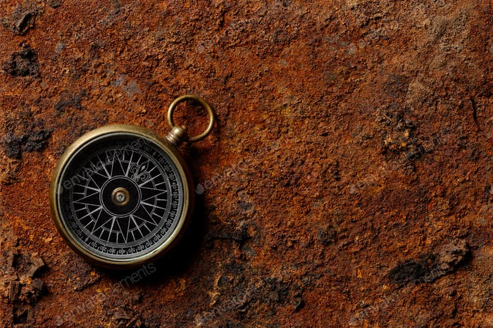 Magnetic compass on rough rusty background