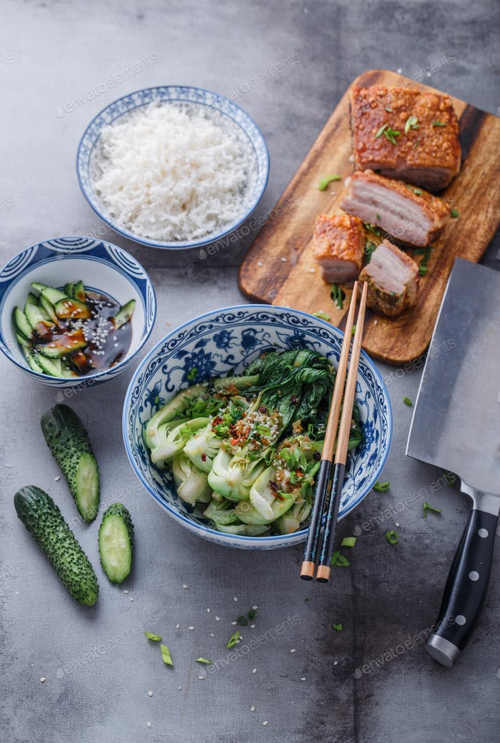 Chinese cuisine stir-fried bok choy and crispy pork belly