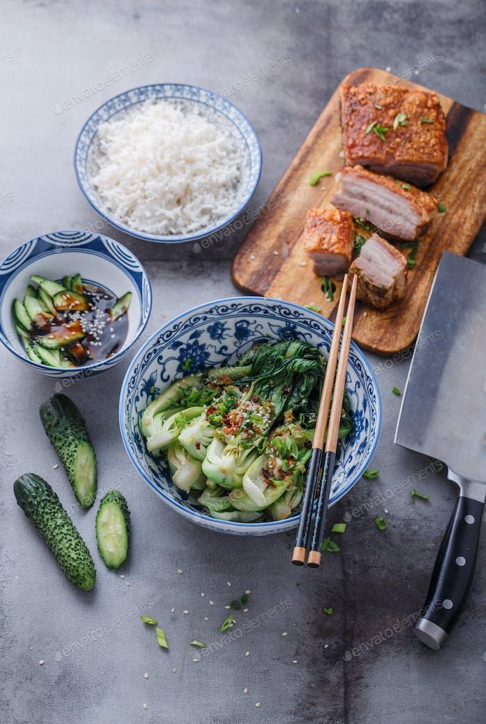 Chinese cuisine stir-fried bok choy and crispy pork belly