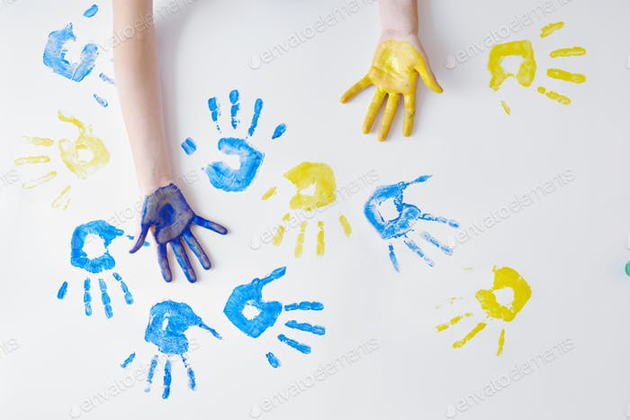 Child hands painted with gouache, art school