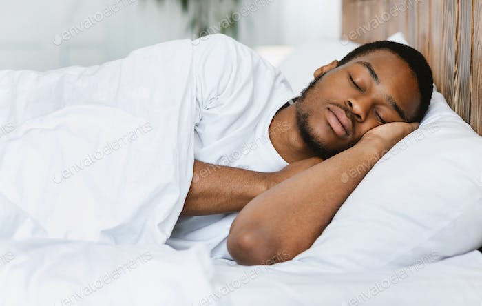 African American Guy Sleeping Resting In His Bed At Home