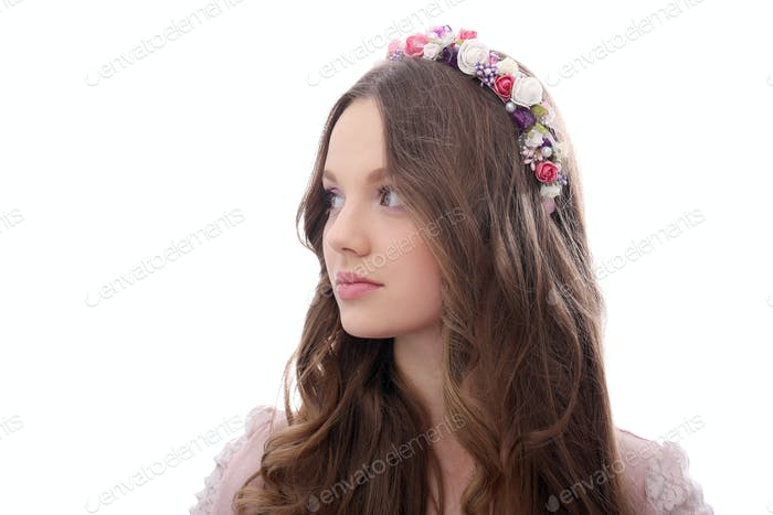 Beautiful girl with flowers at head