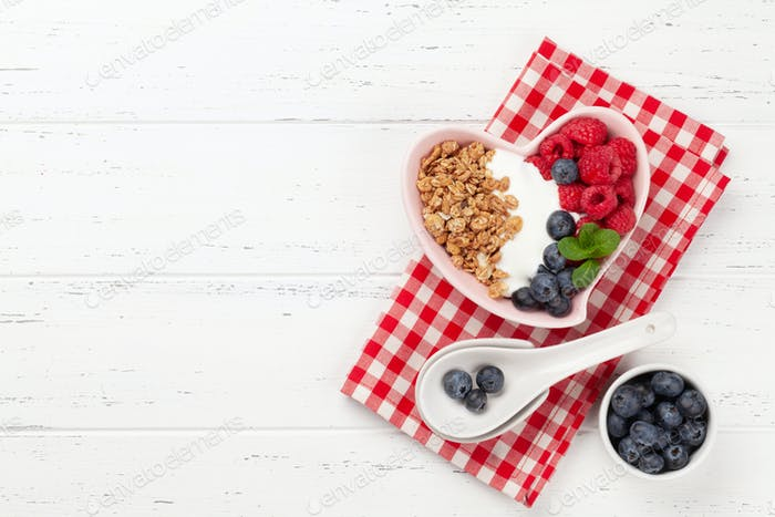 Healthy breakfast with granola, yogurt and berries