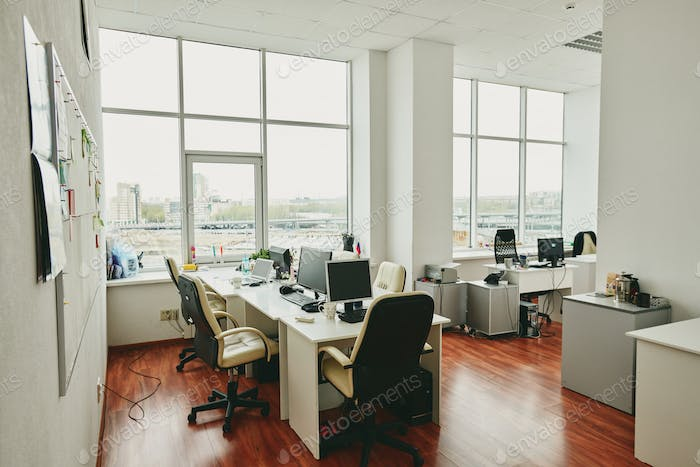 Interior of contemporary office in modern center with furniture and supplies