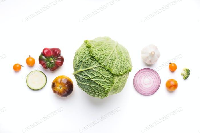 Green vegetable salad with cabbage ingredients on white