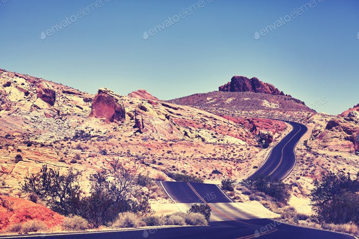 Vintage toned picture of a desert road.