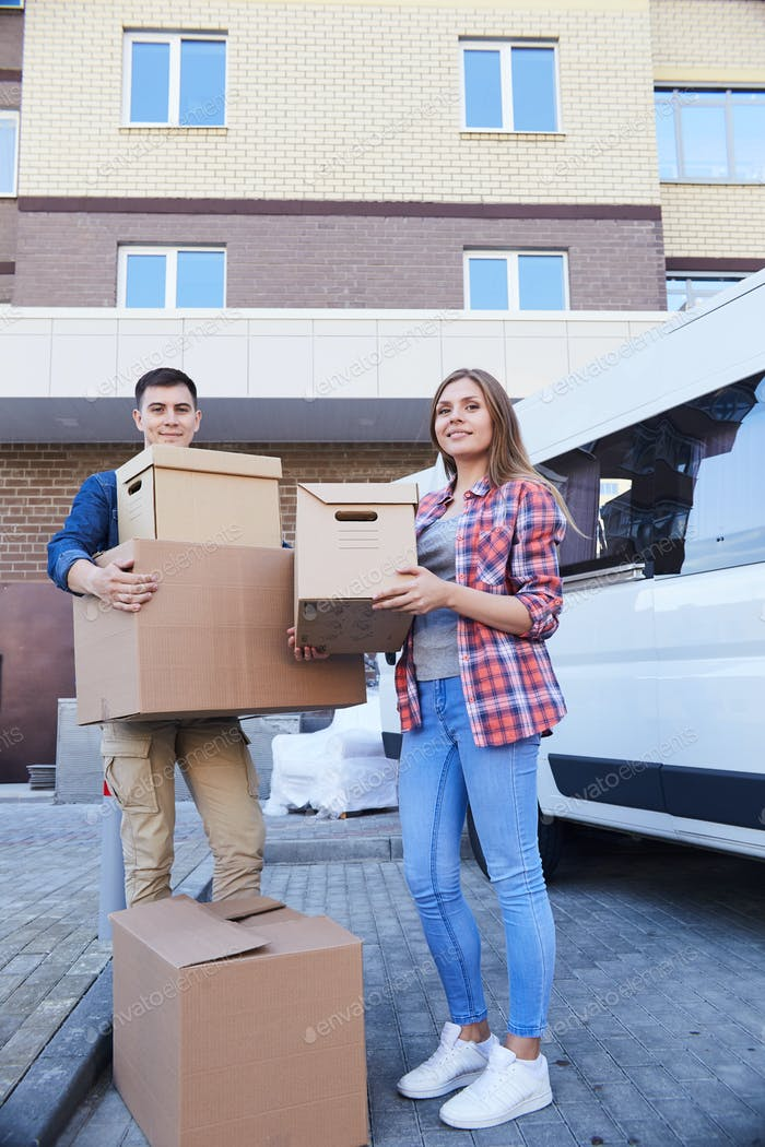 Couple Posing with Boxes Outdoors