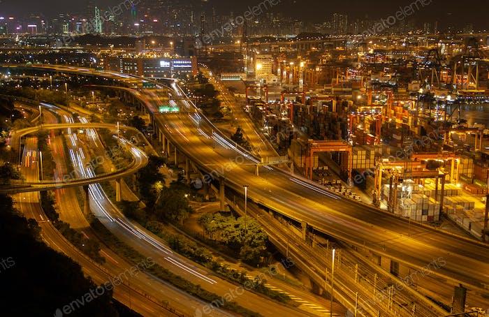 Container port Hong Kong overpass road near modern harbour cranes