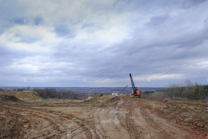 Excavators in the red clay quarry