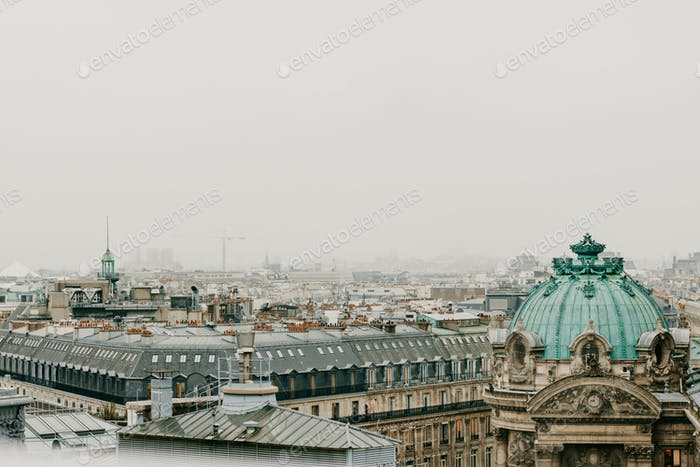 Aerial view of cloudy Paris with grey cloudy sky