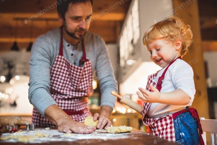 Young family making cookies at home.