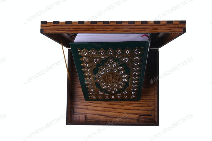 Qur'an in a wooden box isolated top view.