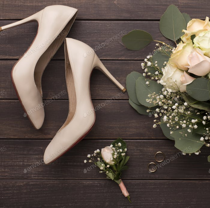 Bride groom creative flat lay of woman shoes and roses bouquet