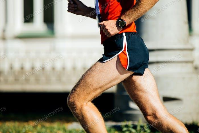 athletic man runs a marathon