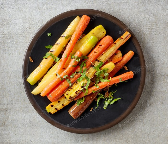 plate of grilled colorful carrots