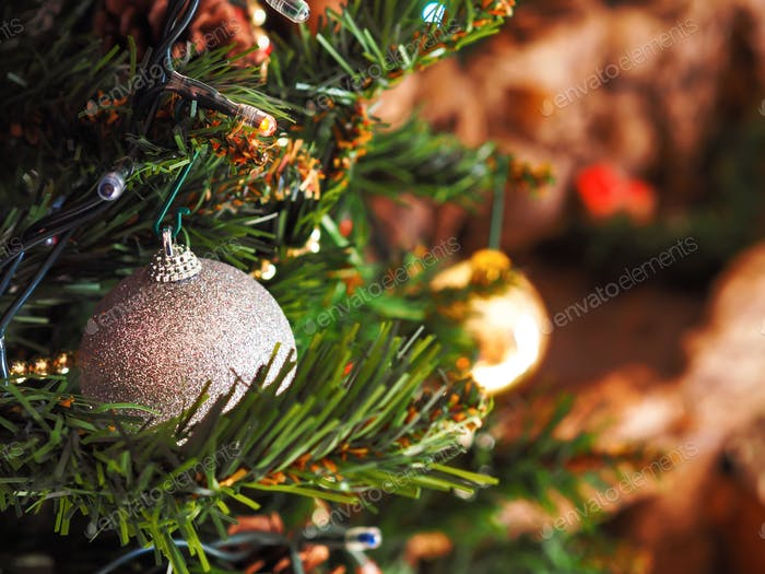 Christmas tree with silver ornament. Festive mood