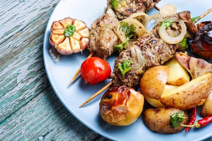 Grilled beef kebab on plate