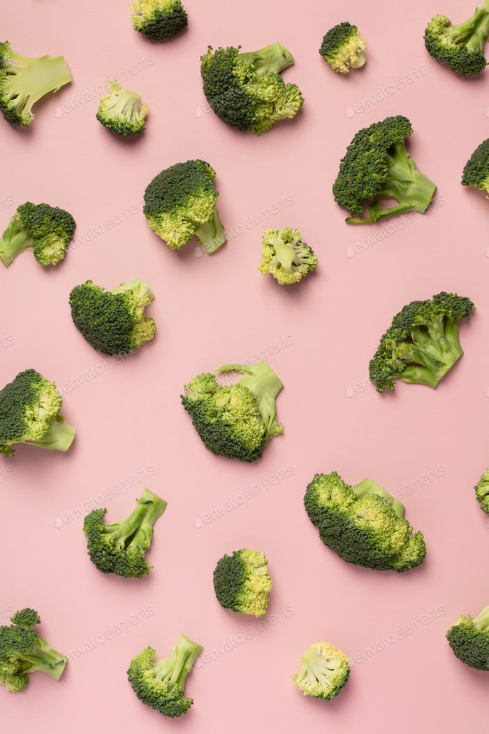 Colorful pattern of broccoli on a pink background