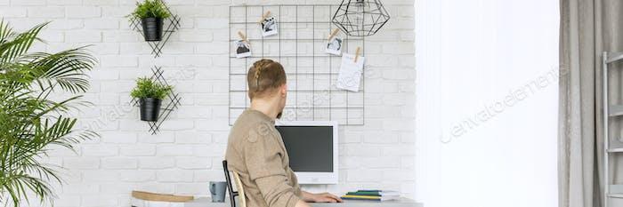 Man sitting in minimalist home office