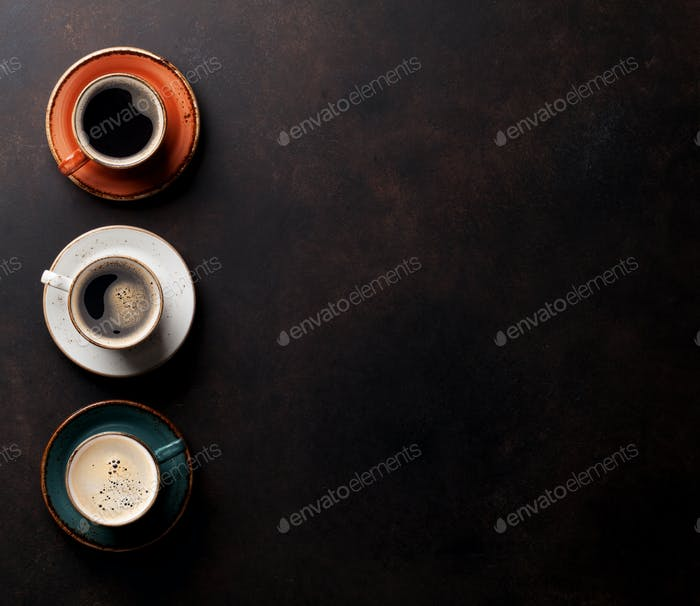 Coffee cups on old kitchen table