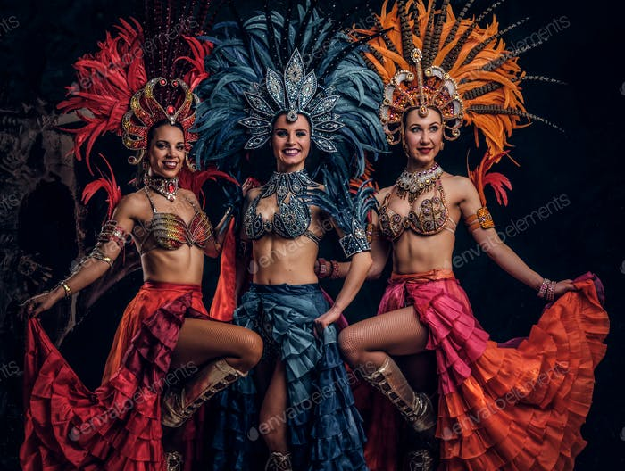 Three beautiful women in traditional brazilian carnival costumes