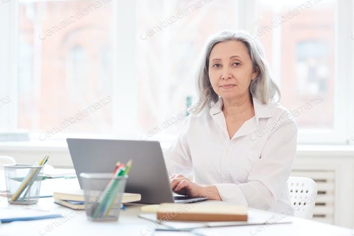 Portrait of Senior Businesswoman at Workplace