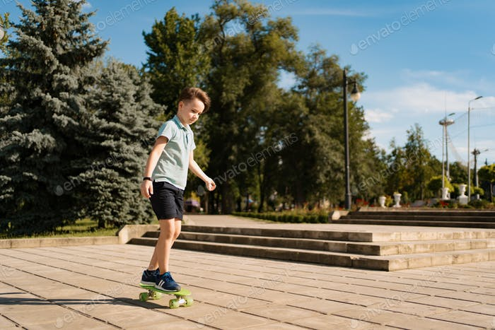 Boy riding on skateboard at the street