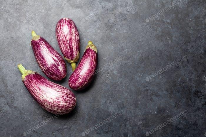 Ripe garden eggplant on stone table