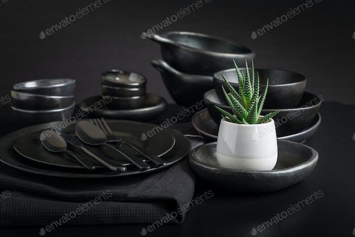 Dishes in minimalistic black design. Pure black.