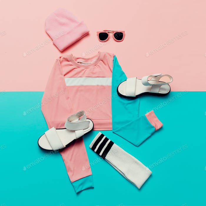 Stylish sports blouse and accessories. Sandals and sunglasses. T