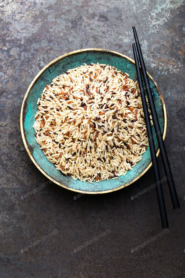 White, brown and black wild rice. Rice in bowl.