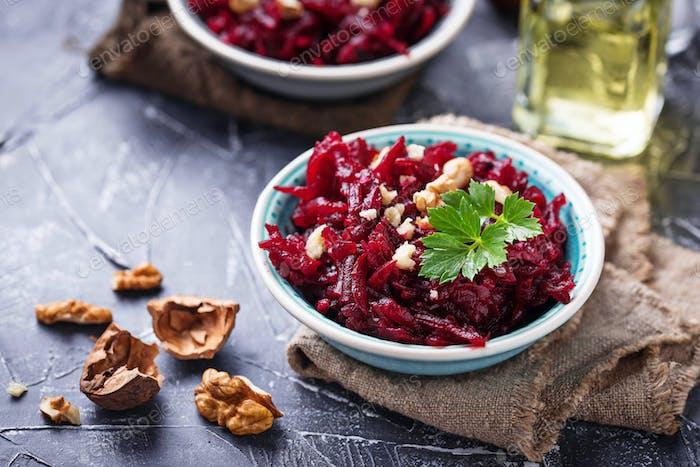 Healthy vegan beetroot salad with walnuts